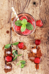 strawberry drinks on wood background