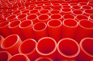 Large Group of Red Industrial Plastic Pipes Full Frame