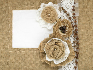 The framework is made of burlap and roses