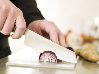 Cutting onion with a knife