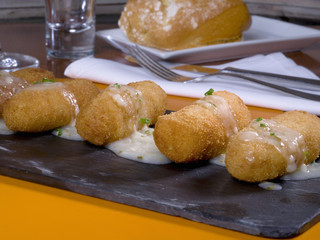 Croquettes in a table of slate