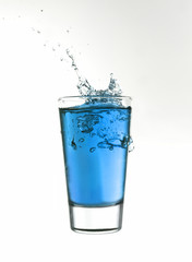 Splash in a glass of blue lemonade