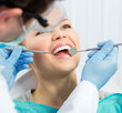 Dental health. Male hygienist examining patient teeth on caries - 80863626