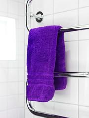 Purple towel on a dryer