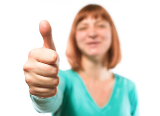 red-haired woman holding thumbs up