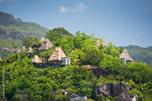 View of Seychelles coastline with houses in the forest - 80863801