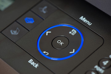 Close up of OK button of a multifunctional device