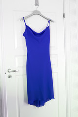 Blue Dress hanging on a door