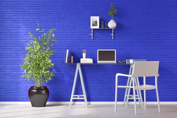 Schreibtisch mit Computer vor Wand