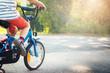 Leinwanddruck Bild - child on a bicycle