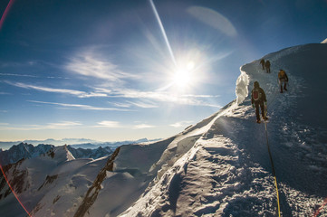 climbers climbing Mont Blanc mountain