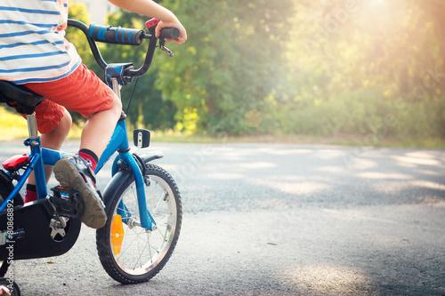 Leinwanddruck Bild child on a bicycle