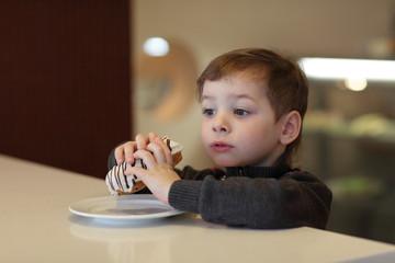 Kid eating eclair