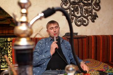 Person smoking hooka