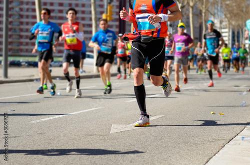 Marathon running race, runners feet on road, sport concept - 80869211