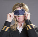 Sleepy aircrew officer using an eye shade