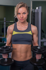 Sports, bodybuilding. Attractive woman in gym.Fitness in the gym