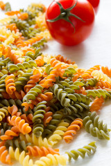 colored pasta with tomato