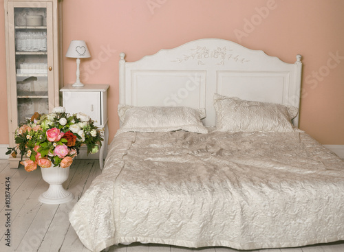 cozy stylish vintage corner of the bedroom with flowers - 80874434