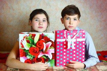 preteen siblings couple boy and girl with presents