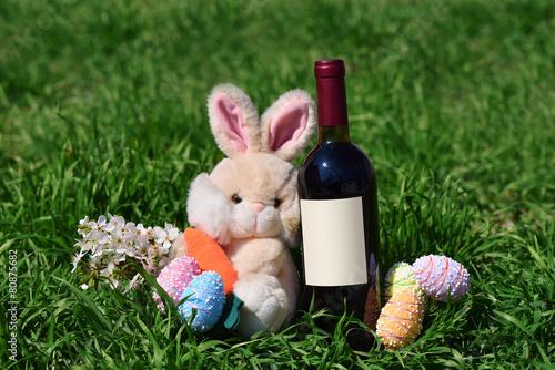 Foto op Plexiglas Uitvoering Row of Easter eggs red wine bottle rabbit in Grass
