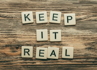 Yourself. Keep it real text on a wooden background