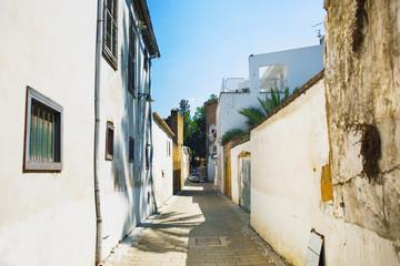 Narrow pedestrian alley between tenement houses