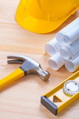 composition of construction tools hammer level helmet blueprints