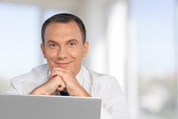 Men. Casual businessman with laptop