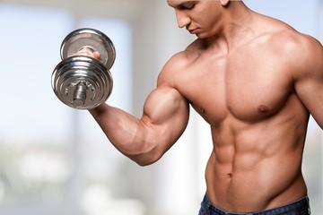 Human Muscle. Bodybuilder exercising