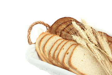 sliced bread with ears of wheat in a basket isolated