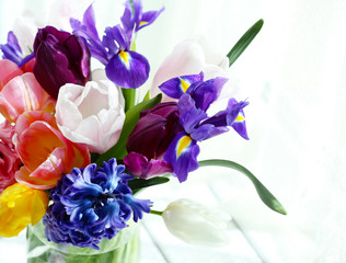 Beautiful bouquet of spring flowers in glass vase