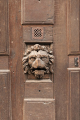 Antique wooden door of half-timbered house, Rouen, Normandy