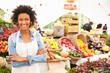 Female Stall Holder At Farmers Fresh Food Market - 80881222