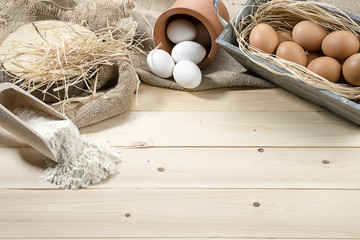 Organic eggs and flour over linen with space for your text