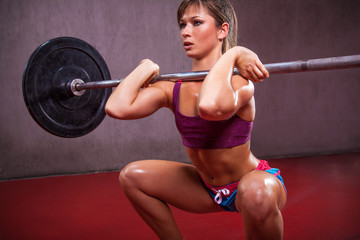 Fit Girl Performing Front Squat