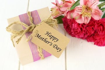 Gift box with Happy Mother's Day tag and pink flowers