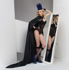 Fashion shot of a woman in a paper crown