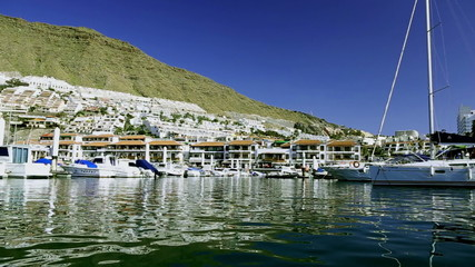 Yachts and boats in port or harbor in Los Gigantes