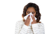 Young woman with cold allergy sneezing blowing her nose