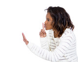 Woman with finger on lips gesture, asking to keep quiet