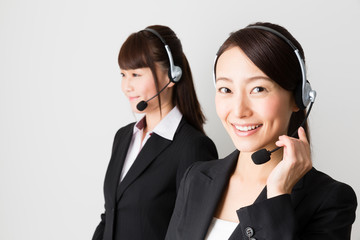 asian businesswomen using headset