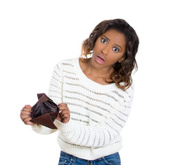 Poor stressed young woman showing empty wallet