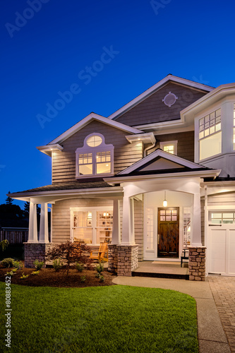Beautiful New England Style Home Exterior at Night - 80883452
