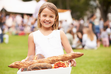 Young Girl With Fresh Bread Bought At Outdoor Farmers Market