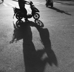 silhouette of motobike and long shadow