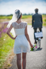 groom leaves his young wife on the side of the road