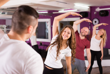 Adults limbering up in gym