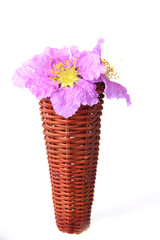 flowers in a wooden vase - Stock Image