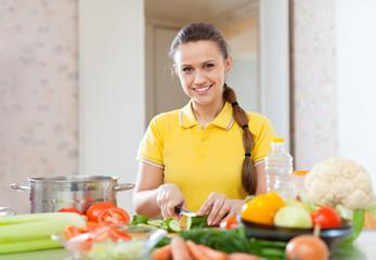happy woman cooking  vegetarian salad